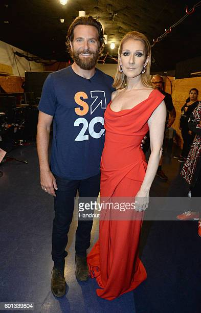 In this handout photo provided by American Broadcasting Companies Inc actor Bradley Cooper and singer Celine Dion attend Stand Up To Cancer a program...