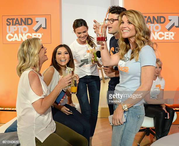In this handout photo provided by American Broadcasting Companies Inc actress Lori Loughlin attends Stand Up To Cancer a program of the Entertainment...