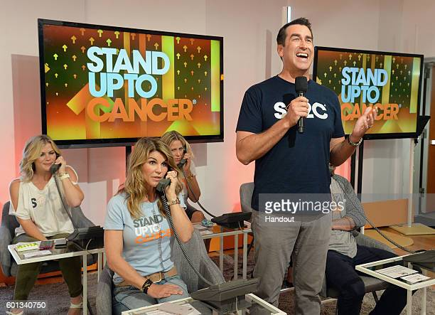 In this handout photo provided by American Broadcasting Companies Inc actors Lori Loughlin and Rob Riggle attend Stand Up To Cancer a program of the...