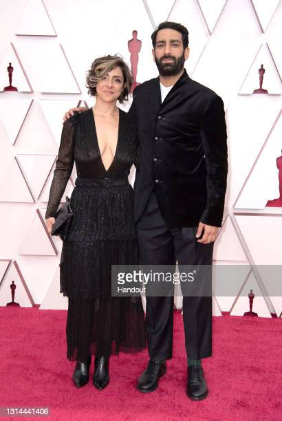 In this handout photo provided by A.M.P.A.S., Alice Doyard attends the 93rd Annual Academy Awards at Union Station on April 25, 2021 in Los Angeles,...
