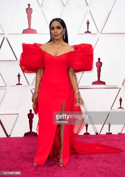 In this handout photo provided by A.M.P.A.S., Angela Bassett attends the 93rd Annual Academy Awards at Union Station on April 25, 2021 in Los...