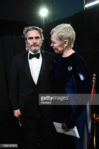 In this handout photo provided by A.M.P.A.S. Best Actor award winner Joaquin Phoenix and Olivia Colman stand backstage during the 92nd Annual Academy...