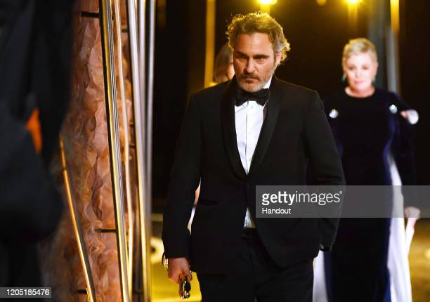 In this handout photo provided by A.M.P.A.S. Best Actor award winner Joaquin Phoenix walks backstage during the 92nd Annual Academy Awards at the...