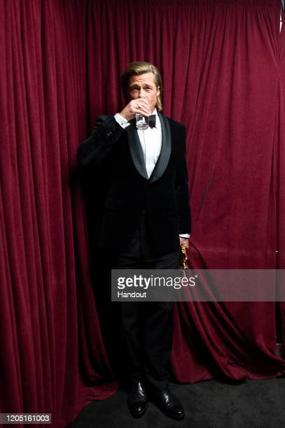 In this handout photo provided by AMPAS Best Actor in a Supporting Role winner Brad Pitt stands backstage during the 92nd Annual Academy Awards at...