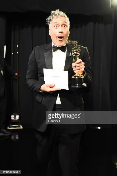 In this handout photo provided by AMPAS Best Adapted Screenplay winner Taika Waititi poses backstage during the 92nd Annual Academy Awards at the...