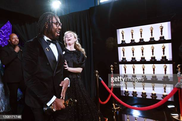 In this handout photo provided by A.M.P.A.S. Best Animated Short Film award winner Matthew A. Cherry walks backstage during the 92nd Annual Academy...