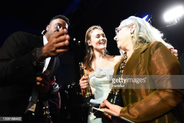 In this handout photo provided by AMPAS Best Documentary winners Elena Andreicheva and Carol Dysinger embrace backstage during the 92nd Annual...