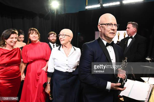 In this handout photo provided by AMPAS Best Feature Documentary winners Lindsay Utz Julie Parker Benello Jeff Reichert Julia Reichert and Steven...