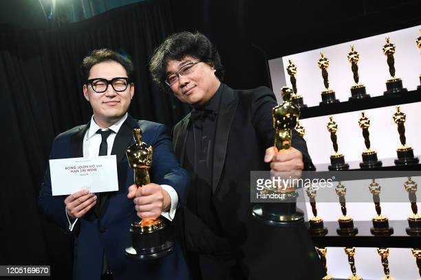 In this handout photo provided by AMPAS Best Original Screenplay award winners Han Jin Won and Bong Joon Ho pose backstage during the 92nd Annual...