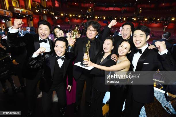 "In this handout photo provided by A.M.P.A.S. Best Picture Award winners for ""Parasite"" pose onstage during the 92nd Annual Academy Awards at the..."