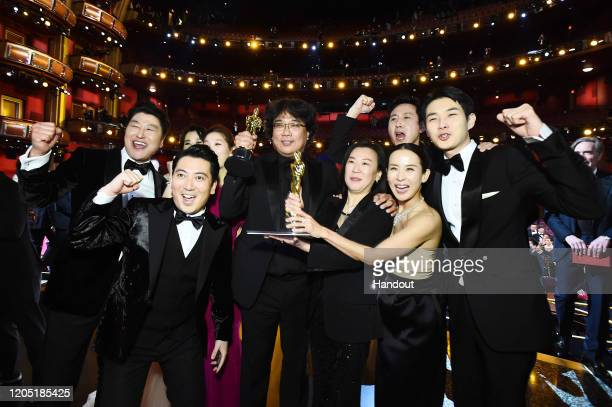 """In this handout photo provided by A.M.P.A.S. Best Picture Award winners for """"Parasite"""" pose onstage during the 92nd Annual Academy Awards at the..."""