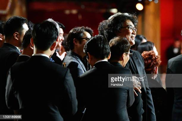 In this handout photo provided by AMPAS Best Picture Award winners for Parasite pose onstage during the 92nd Annual Academy Awards at the Dolby...