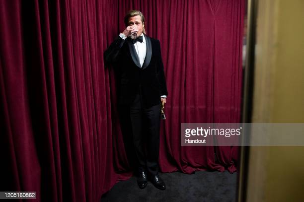 In this handout photo provided by AMPAS Brad Pitt stands backstage during the 92nd Annual Academy Awards at the Dolby Theatre on February 09 2020 in...