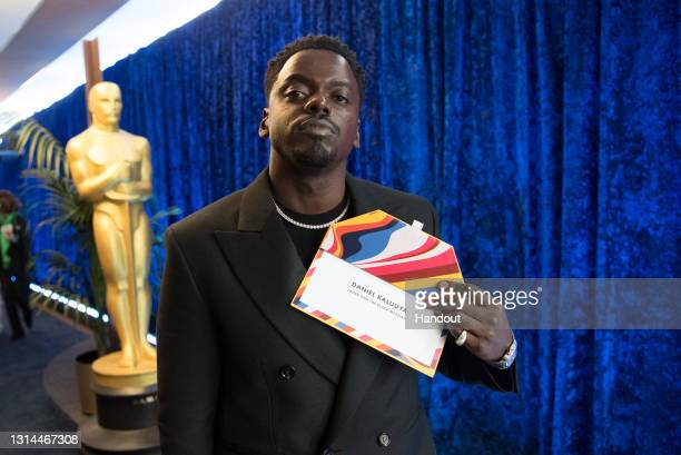 In this handout photo provided by A.M.P.A.S., Daniel Kaluuya backstage with the Oscar® for Best Actor in a Supporting Role during the 93rd Annual...
