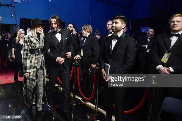 In this handout photo provided by A.M.P.A.S. Diane Keaton and Keanu Reeves walk backstage during the 92nd Annual Academy Awards at the Dolby Theatre...