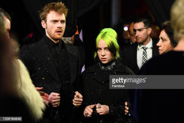 In this handout photo provided by AMPAS Finneas and Billie Eilish stand backstage during the 92nd Annual Academy Awards at the Dolby Theatre on...