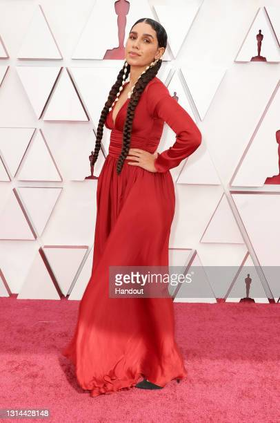 In this handout photo provided by A.M.P.A.S., Garrett Bradley attends the 93rd Annual Academy Awards at Union Station on April 25, 2021 in Los...
