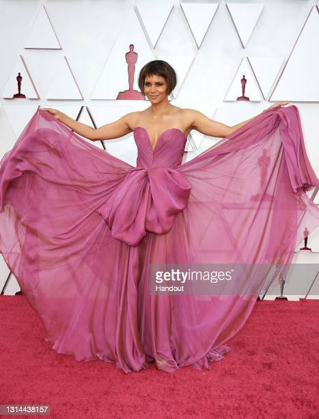 In this handout photo provided by A.M.P.A.S., Halle Berry attends the 93rd Annual Academy Awards at Union Station on April 25, 2021 in Los Angeles,...