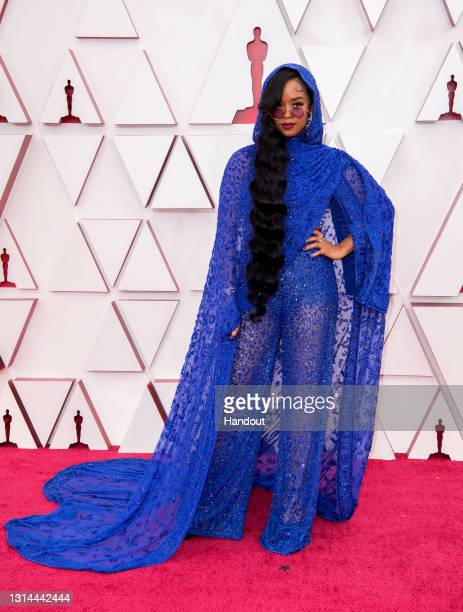 In this handout photo provided by A.M.P.A.S., H.E.R. Attends the 93rd Annual Academy Awards at Union Station on April 25, 2021 in Los Angeles,...