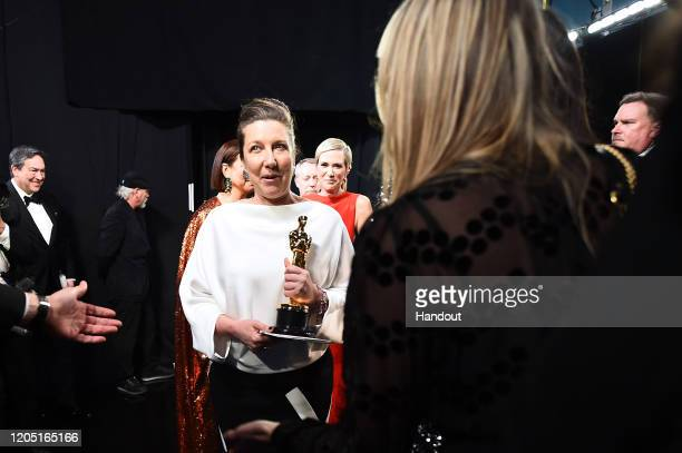 In this handout photo provided by AMPAS Jacqueline Durran poses with the Best Costume Design award backstage during the 92nd Annual Academy Awards at...