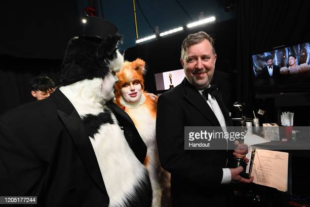 In this handout photo provided by AMPAS James Corden Rebel Wilson and Visual Effects award winner Greg Butler walk backstage during the 92nd Annual...