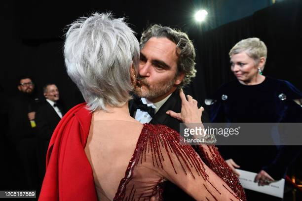 In this handout photo provided by A.M.P.A.S. Jane Fonda and Best Actor award winner Joaquin Phoenix enbrace backstage during the 92nd Annual Academy...