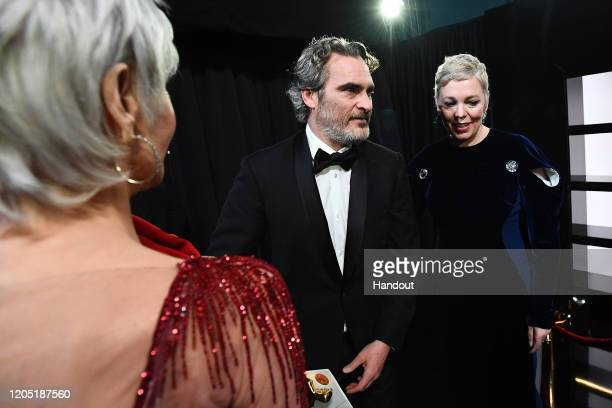 In this handout photo provided by A.M.P.A.S. Jane Fonda, Best Actor award winner Joaquin Phoenix, and Olivia Colman stand backstage during the 92nd...