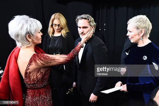 In this handout photo provided by AMPAS Jane Fonda Best Actor award winner Joaquin Phoenix and Olivia Colman stand backstage during the 92nd Annual...