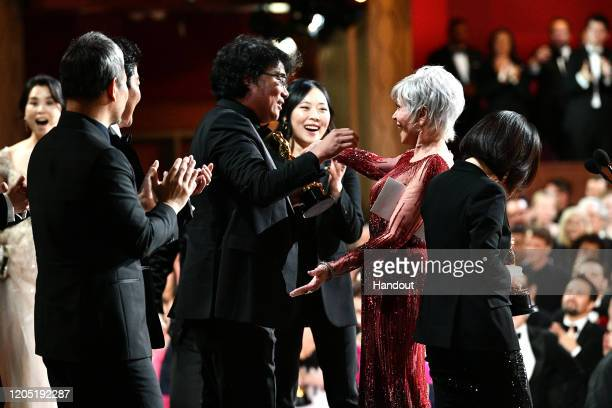 In this handout photo provided by AMPAS Jane Fonda presents the Best Picture award onstage to Bong Joon Ho and the Parasite team during the 92nd...