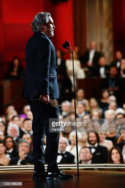 """In this handout photo provided by A.M.P.A.S. Joaquin Phoenix accepts the Best Actor award for """"Joker"""" onstage during the 92nd Annual Academy Awards..."""