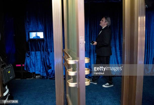 In this handout photo provided by A.M.P.A.S., Joaquin Phoenix backstage during the 93rd Annual Academy Awards at Union Station on April 25, 2021 in...
