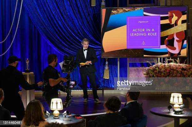 In this handout photo provided by A.M.P.A.S., Joaquin Phoenix presents the Oscar for Actor in a Leading Role the 93rd Annual Academy Awards at Union...