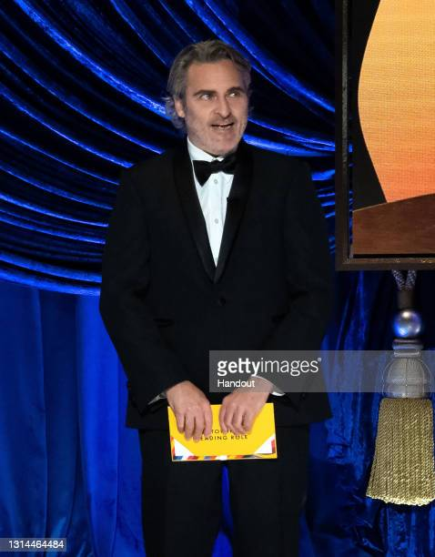 In this handout photo provided by A.M.P.A.S., Joaquin Phoenix presents the Oscar for Actor in a Leading Role during the 93rd Annual Academy Awards at...