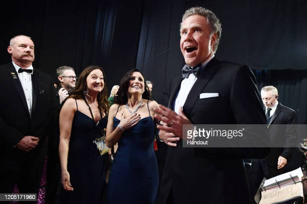In this handout photo provided by A.M.P.A.S. Julia Louis-Dreyfus and Will Ferrell walk backstage during the 92nd Annual Academy Awards at the Dolby...