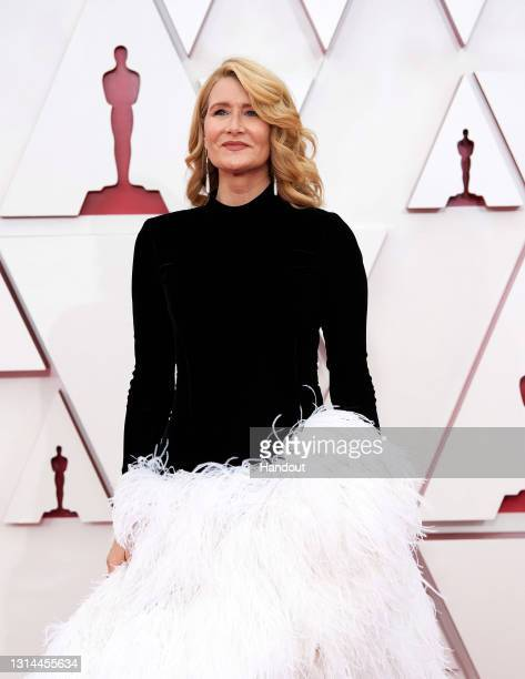 In this handout photo provided by A.M.P.A.S., Laura Dern attends the 93rd Annual Academy Awards at Union Station on April 25, 2021 in Los Angeles,...