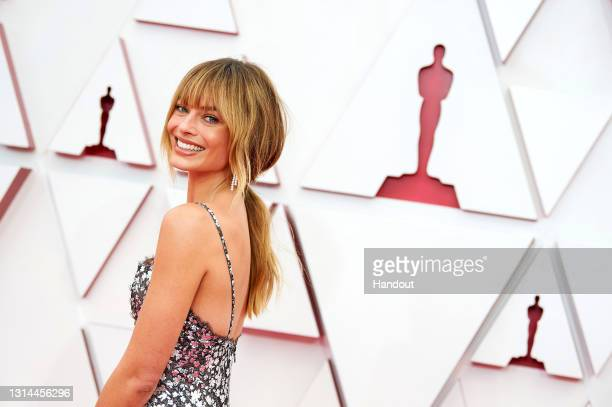 In this handout photo provided by A.M.P.A.S., Margot Robbie attends the 93rd Annual Academy Awards at Union Station on April 25, 2021 in Los Angeles,...