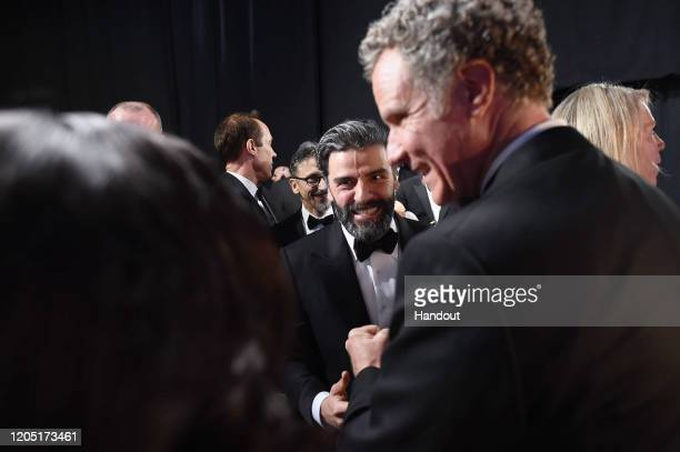 In this handout photo provided by A.M.P.A.S. Oscar Isaac and Will Ferrell speak backstage during the 92nd Annual Academy Awards at the Dolby Theatre...