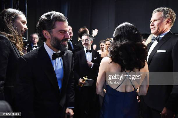 In this handout photo provided by A.M.P.A.S. Oscar Isaac, Julia Louis-Dreyfus, and Will Ferrell stand backstage during the 92nd Annual Academy Awards...