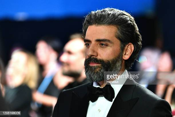 In this handout photo provided by AMPAS Oscar Isaac looks on backstage during the 92nd Annual Academy Awards at the Dolby Theatre on February 09 2020...