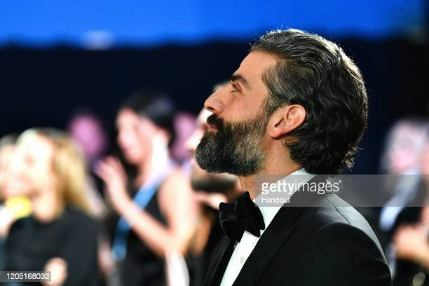In this handout photo provided by A.M.P.A.S. Oscar Isaac looks on backstage during the 92nd Annual Academy Awards at the Dolby Theatre on February...