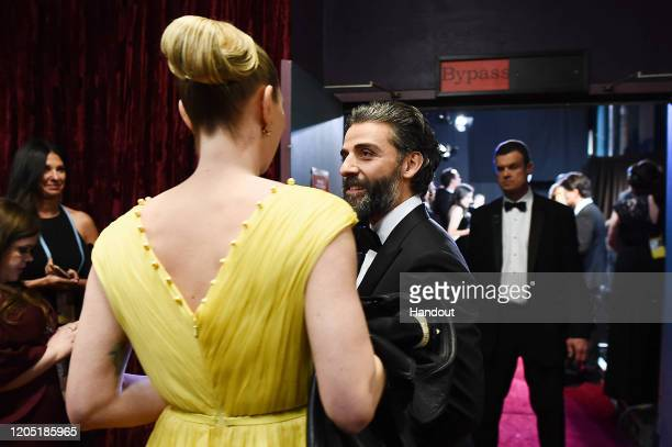 In this handout photo provided by A.M.P.A.S. Oscar Isaac stands backstage during the 92nd Annual Academy Awards at the Dolby Theatre on February 09,...