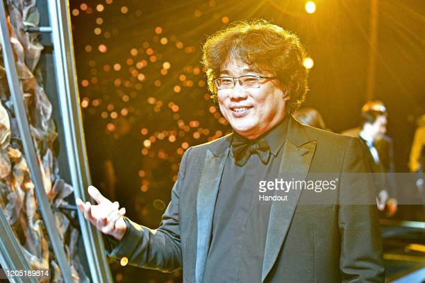 In this handout photo provided by AMPAS Oscar winner Bong Joon Ho poses backstage during the 92nd Annual Academy Awards at the Dolby Theatre on...
