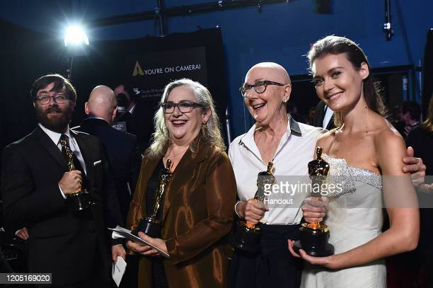 In this handout photo provided by AMPAS Oscar winners Jeff Reichert Carol Dysinger Julia Reichert and Elena Andreicheva pose backstage during the...