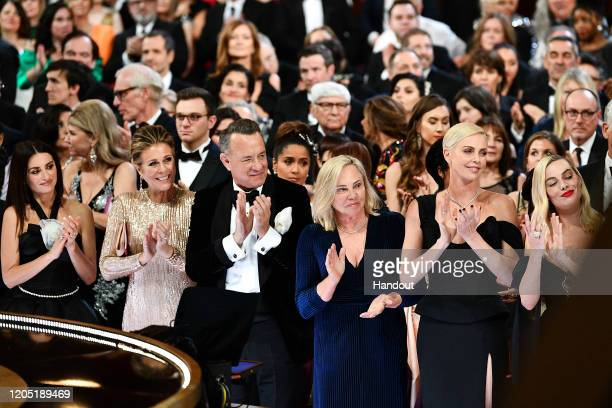In this handout photo provided by AMPAS Penélope Cruz Rita Wilson Tom Hanks Charlize Theron and Margot Robbie stand in the front row during the 92nd...