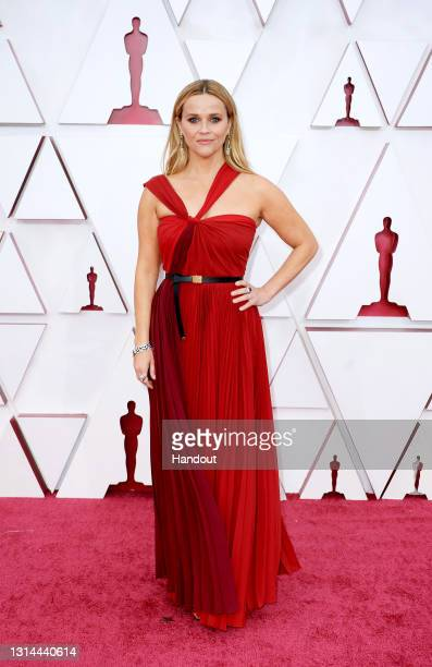 In this handout photo provided by A.M.P.A.S., Reese Witherspoon attends the 93rd Annual Academy Awards at Union Station on April 25, 2021 in Los...