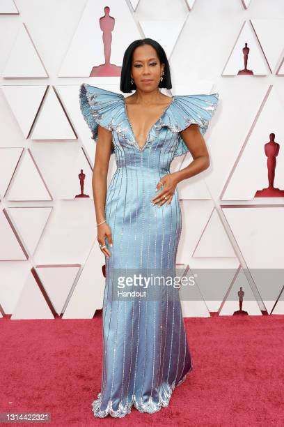 In this handout photo provided by A.M.P.A.S., Regina King attends the 93rd Annual Academy Awards at Union Station on April 25, 2021 in Los Angeles,...