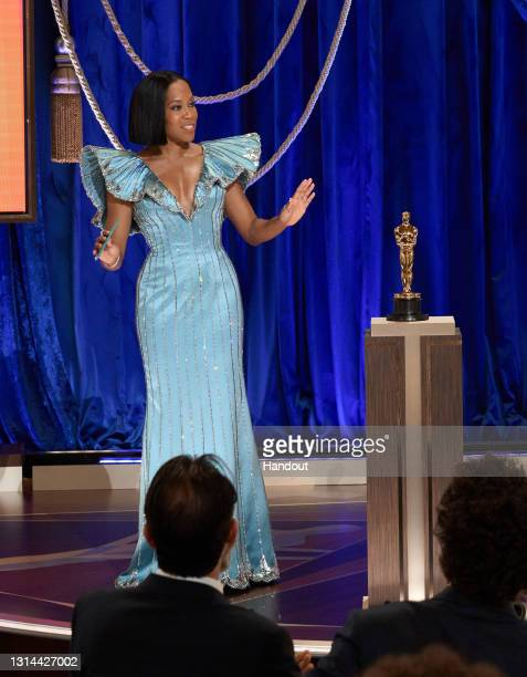 In this handout photo provided by A.M.P.A.S., Regina King presents the Oscar® for Original Screenplay onstage during the 93rd Annual Academy Awards...