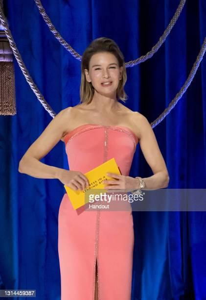 In this handout photo provided by A.M.P.A.S., Renée Zellweger presents the Oscar for Actress in a Leading Role the 93rd Annual Academy Awards at...
