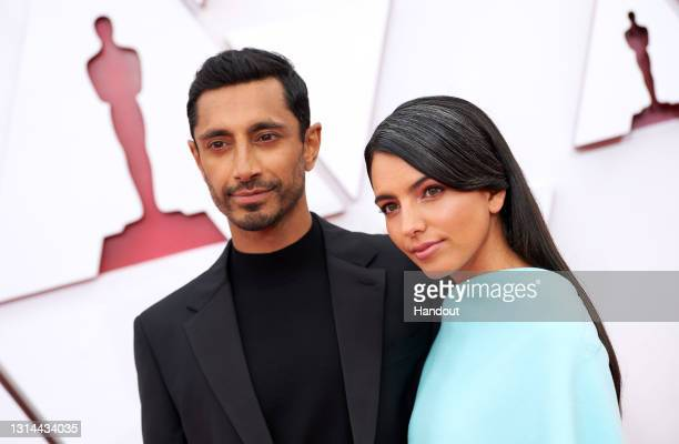 In this handout photo provided by A.M.P.A.S., Riz Ahmed and Fatima Farheen Mirza attend the 93rd Annual Academy Awards at Union Station on April 25,...