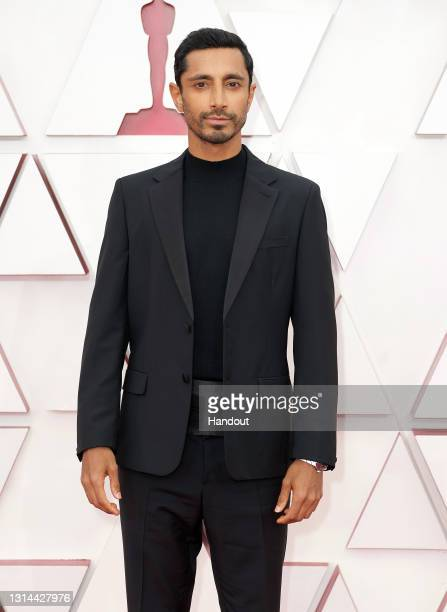 In this handout photo provided by A.M.P.A.S., Riz Ahmed attends the 93rd Annual Academy Awards at Union Station on April 25, 2021 in Los Angeles,...